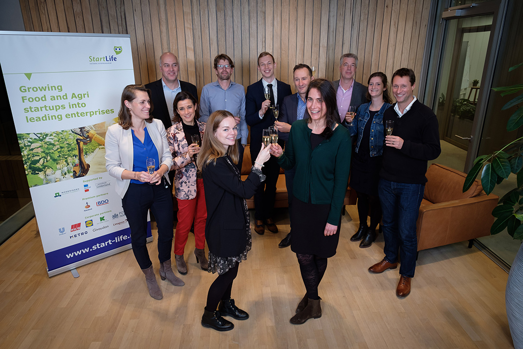 Team of StartLife and Limagrain toasting on the kickoff of their partnership