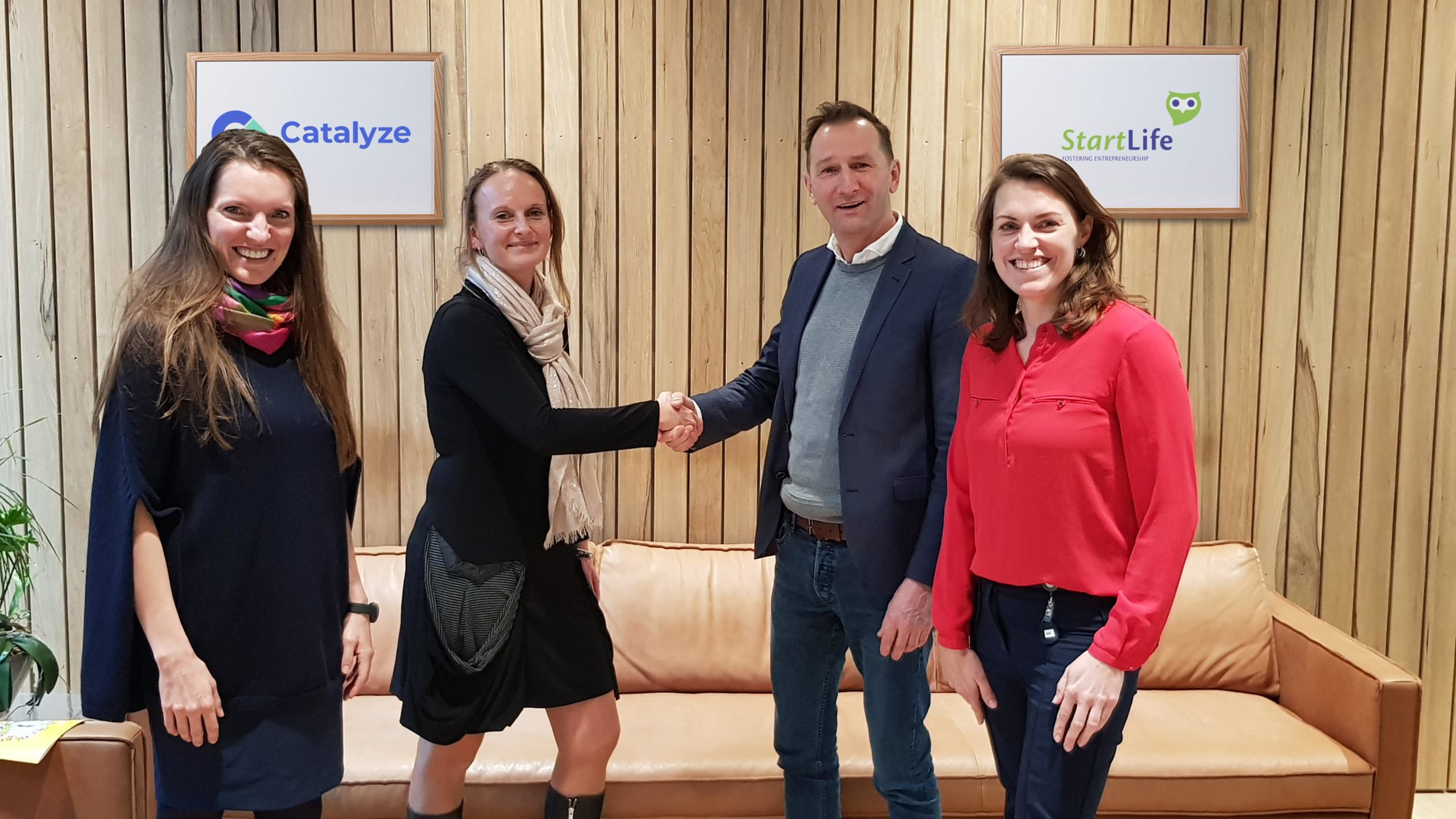 Neeltje Ramnaths of Catalyze and Jan Meiling of StartLife shake hands after signing strategic partnership